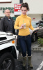 Britney Spears spotted heading to Starbucks in Calabasas California on January 26th 2010 wearing a yellow high neck top 5