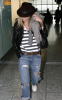 Jennifer Aniston spotted at Heathrow Airport on November 30th 2009 wearing a brown leather hat and torn stylish denim pants 1
