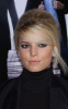 Jessica Simpson attends the Extraordinary Measures movie Premiere on January 19th 2010 wearing black 5