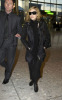 Madonna spotted on January 29th 2010 as she was about to catch a flight from Londons Heathrow Airport to New York City 5