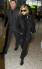 Madonna spotted on January 29th 2010 as she was about to catch a flight from Londons Heathrow Airport to New York City 4