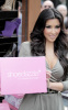 Kim Kardashian arrives at ShoeDazzle on January 29th 2010 at the Westfield Century City Shopping Mall wearing a cute silver dress 1