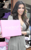 Kim Kardashian arrives at ShoeDazzle on January 29th 2010 at the Westfield Century City Shopping Mall wearing a cute silver dress 7