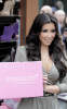 Kim Kardashian arrives at ShoeDazzle on January 29th 2010 at the Westfield Century City Shopping Mall wearing a cute silver dress 2