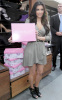 Kim Kardashian arrives at ShoeDazzle on January 29th 2010 at the Westfield Century City Shopping Mall wearing a cute silver dress 6