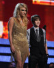 Justin Bieber with singer KeSha onstage during the 52nd Annual GRAMMY Awards held at Staples Center on January 31st 2010 in Los Angeles California 3