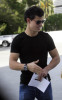 Taylor Lautner spotted walking the streets on January 9th 2010 wearing a black tshirt and sunglasses 5