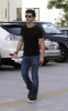 Taylor Lautner spotted walking the streets on January 9th 2010 wearing a black tshirt and sunglasses 2