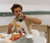 Robert Pattinson photo shoot of December 2009 issue of Vanity Fair Magazine eating a meal 2