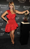 Beyonce Knowles was spotted at the Launch of her new fragrance Heat on February 2nd 2010 wearing a stylish short red dress 5