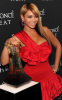 Beyonce Knowles was spotted at the Launch of her new fragrance Heat on February 2nd 2010 wearing a stylish short red dress 3