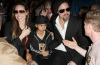 Angelina Jolie with Brad Pitt and their son Maddox spotted together on February 7th 2010 while leaving Super Bowl XLIV at the Sun Life Stadium in Miami Gardens Florida 3