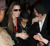 Angelina Jolie with Brad Pitt and their son Maddox spotted together on February 7th 2010 while leaving Super Bowl XLIV at the Sun Life Stadium in Miami Gardens Florida 6