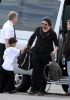 Brad Pitt and his son Maddox spotted on February 8th 2010 as they took a private jet in Miami Florida 4