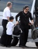 Brad Pitt and his son Maddox spotted on February 8th 2010 as they took a private jet in Miami Florida 3
