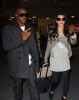 Kim Kardashian and Reggie Bush spotted at McCarron International Airport on February 13th 2010 in Las Vegas Nevada 3