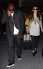 Kim Kardashian and Reggie Bush spotted at McCarron International Airport on February 13th 2010 in Las Vegas Nevada 2