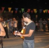Basel Khoury picture while playing the guitar and performing on stage at a concert 16