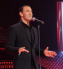 Star Academy season seven first prime picture of Kathem Saher singing on stage