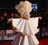 Lady Gaga wears a white layered dress as she arrives to The Brit Awards on February 16th 2010 at Earls Court in London England 3
