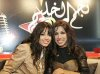 picture of Iraqi student Rahma Mezher while at Najm Al Khaleej competition with a friend