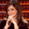 Zena Aftimos from Syria photo while singing on stage at the 1st prime of star academy7