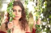 Haifa Wehbe desktop Wallpaper wearing a red dress at a garden like scene 1