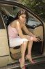 Haifa Wehbe desktop Wallpaper inside the car wearing white shorts and a pink top 2