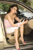 Haifa Wehbe desktop Wallpaper inside the car wearing white shorts and a pink top 1