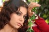 Haifa Wehbe desktop Wallpaper wearing a red dress at a garden like scene 3