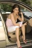 Haifa Wehbe desktop Wallpaper inside the car wearing white shorts and a pink top 3