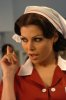 Haifa Wehbe large size photo wearing a red nurse outfit 11
