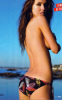 Audrina Patridge photo shoot for the April 2010 issue of FHM Magazine while posing topless on the beach