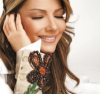 new photo shoot of Asala Nasri with a bronze makeup style