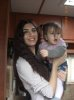 turkish model and actress Tuba Buyukustun with a little cute baby girl