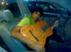 photo of Saudi student Sultan Bin Rashed with his guitar