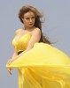 Rula Saed picture of April 12th 2010 while on the filming set of her new video clip Shayfak Oddami wearing a glam yellow dress 5