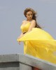 Rula Saed picture of April 12th 2010 while on the filming set of her new video clip Shayfak Oddami wearing a glam yellow dress 2