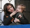 Knox Jolie Pitt drops his doll bunny off his the balcony while with his mother Angelina Jolie on April 9th 2010 in Venice Italy 5