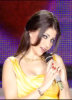 Haifa Wehbe singing on stage wearing a stylish yellow dress 2