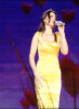 Haifa Wehbe singing on stage wearing a stylish yellow dress 1