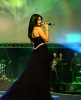 Haifa Wehbe picture while singing on stage during a live concert wearing a glam black dress 2