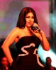 Haifa Wehbe picture while singing on stage during a live concert wearing a glam black dress 1