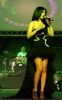 Haifa Wehbe picture while singing on stage during a live concert wearing a glam black dress 3