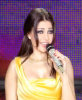 Haifa Wehbe singing on stage wearing a stylish yellow dress 3
