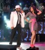 Tamer Hosny with Merhan Hussein on stage during a summer concert 2