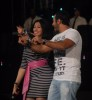 Tamer Hosny with Merhan Hussein on stage during a summer concert 8