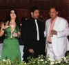 Haifa Wehbe picture with her husband Ahmed abo Hashimah wearing a green dress