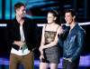 Taylor Lautner speak on stage along with Robert Pattinson and Kristen Stewart during the 2010 MTV Movie Awards held at the Gibson Amphitheatre on June 6th 2010 at Universal Studios in California 4
