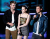 Taylor Lautner speak on stage along with Robert Pattinson and Kristen Stewart during the 2010 MTV Movie Awards held at the Gibson Amphitheatre on June 6th 2010 at Universal Studios in California 3